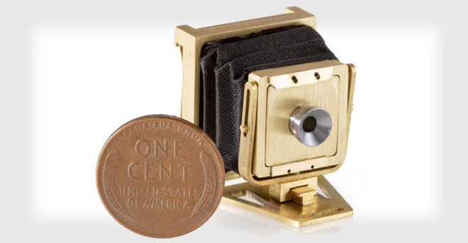 This is the smallest working folding camera in the World, no bigger than a dime - Photo 1.