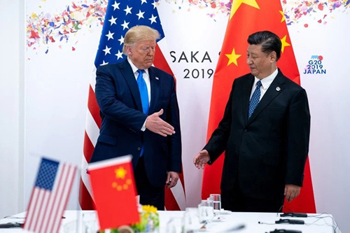 US President Trump, left, and Chinese President Xi Jinping, during a meeting in Osaka, Japan in June 2019. Photo: NYT.