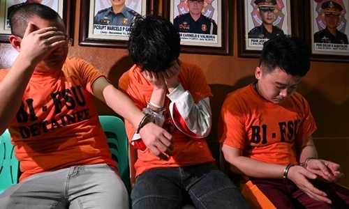 Three Chinese nationals were arrested for involvement in illegal online gambling in Manila on September 16. Photo: AFP.