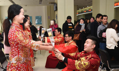 Couples wear traditional wedding dresses to receive marriage registration in Shijiazhuang citadel, Hebei province, China in February 2017. Photo: Chinanews.