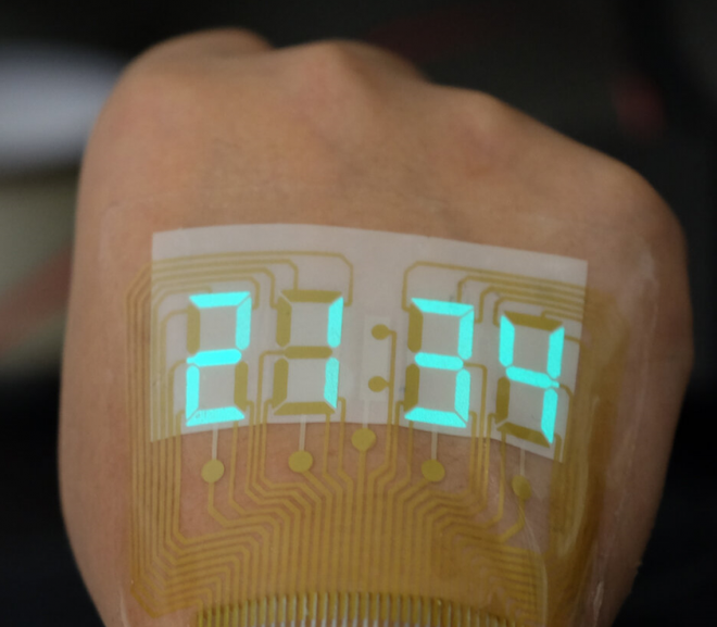 China made an ultra-thin and flexible screen that can be glued to skin - Photo 1.