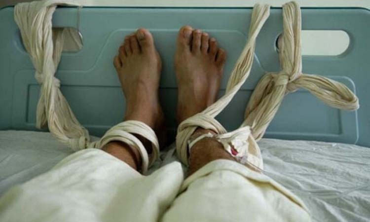 A mental patient in Fuzhou City, Fujian Province, China was tied up during a blood transfusion. Photo: AFP.