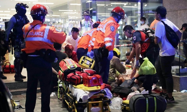 Ambulance personnel present at the scene of the knife attack in Hong Kong on November 3. Photo: SCMP