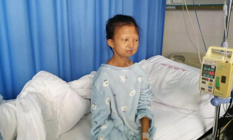 Wu Huayan at the hospital. Photo: Kerry Allen / Twitter