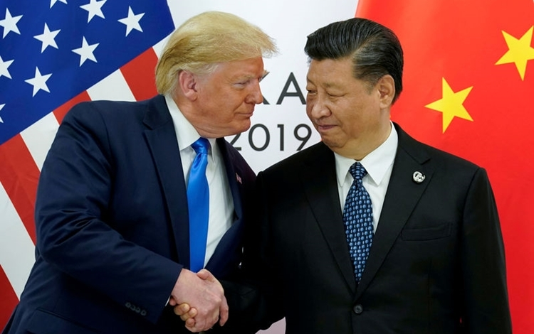US President Donald Trump (left) and Chinese President Xi Jinping at the G20 summit in Osaka, Japan on June 29. Photo: Reuters.