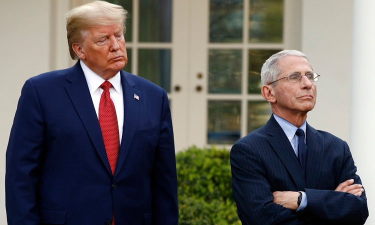 Former US President Donald Trump (left) and Dr. Anthony Fauci at a meeting at the Rose Garden, White House, March 29, 2020.  Photo: AP.