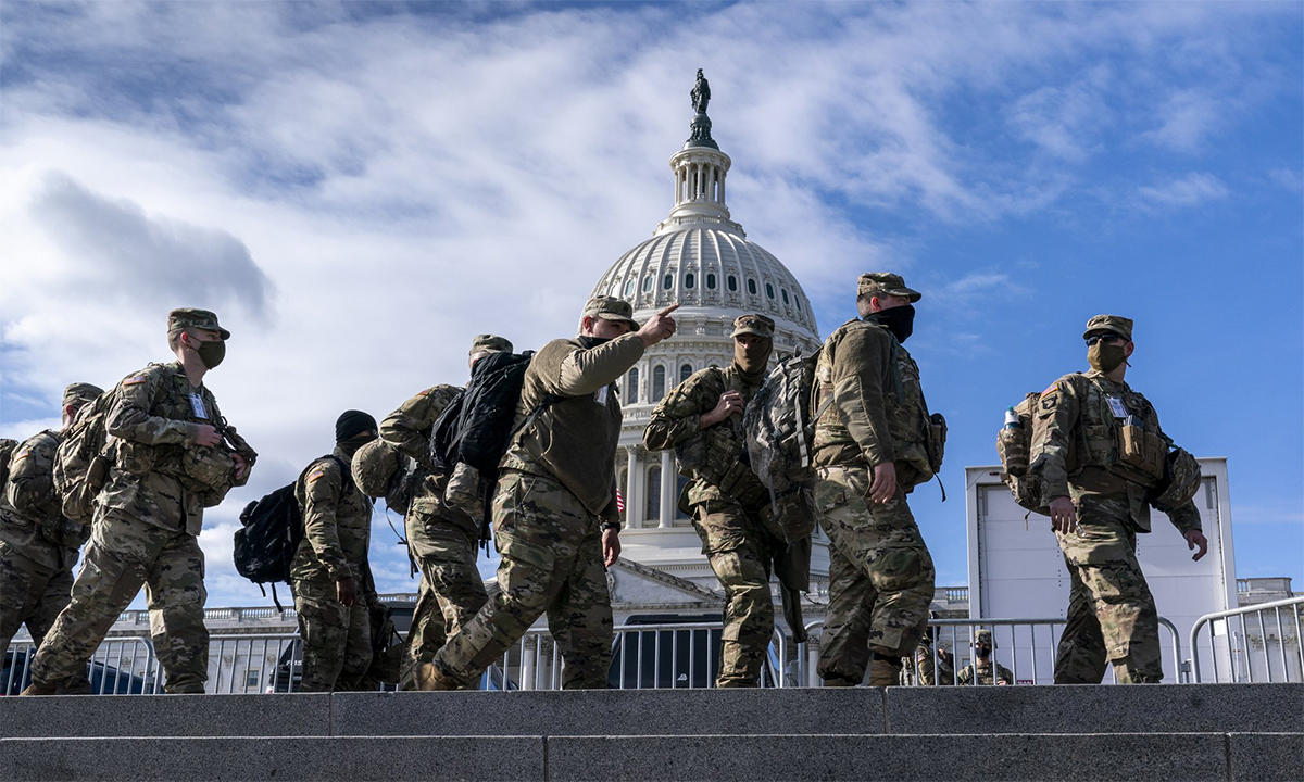 National Guard soldiers pass in front of the US Congress building, January 17.  Photo: AP.