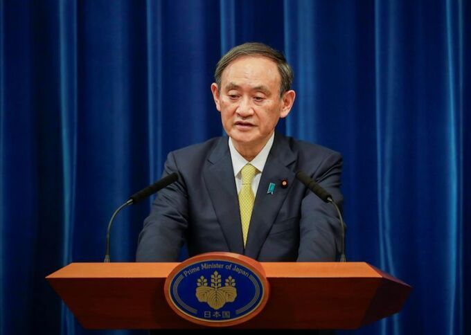 Japanese Prime Minister Yoshihide Suga during a press conference in Tokyo last December.  Photo: Reuters.