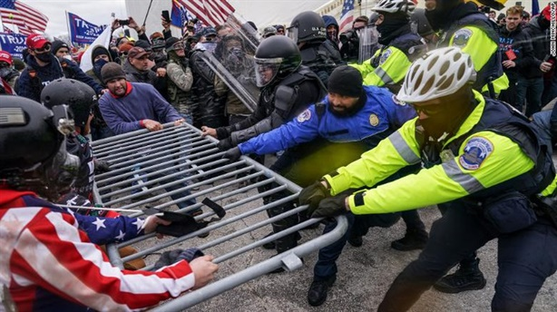 Americans divided, worried about riot the day Mr. Biden took office