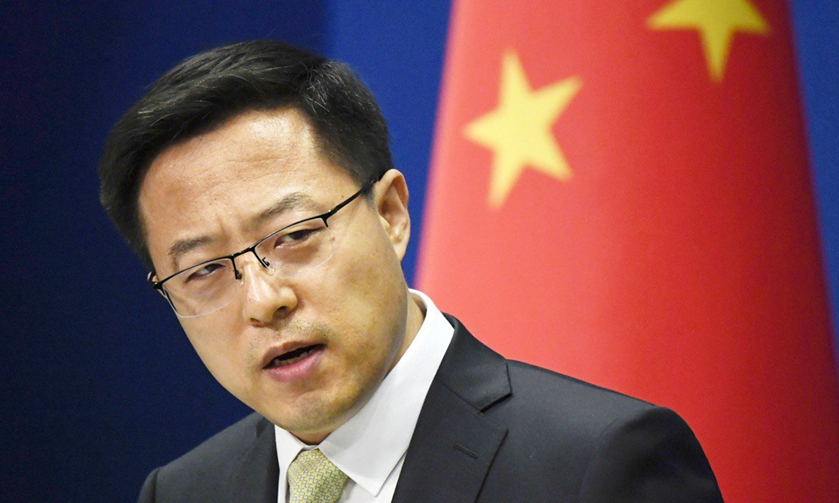 Foreign Ministry spokesperson Zhao Lap Kien at a press conference in Beijing.  Photo: Kyodo.