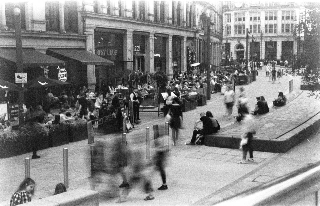 A busy street scene at Exchange Square after the first lockdown, Manchester, UK
