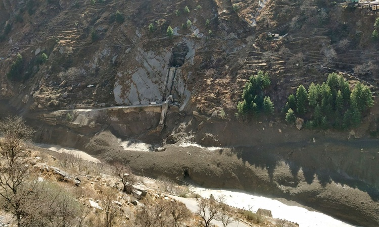 The dam was damaged after a glacier in the Himalayas broke and collapsed in the village of Raini Chak Lata, district Chamoli, north of Uttarakhand state, India, February 7.  Photo: Reuters.