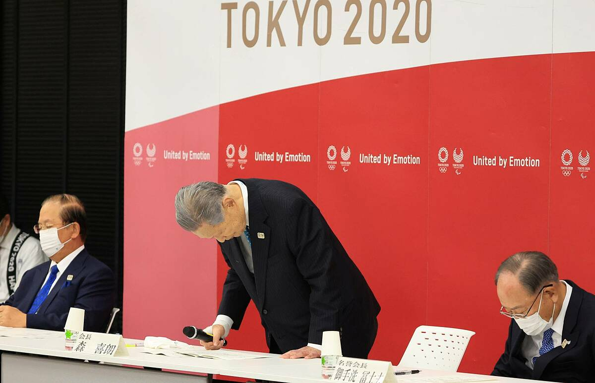 Mr. Mori bowed his head in apology after announcing his resignation on February 13.  Photo: Reuters