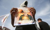 A soldier holding a portrait of General Qassem Soleimani.  Photo: Reuters