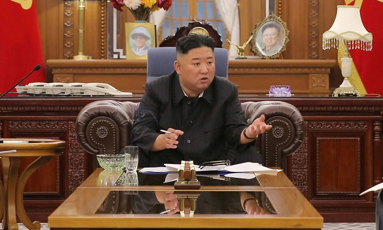 This undated photo released on June 8 shows North Korean leader Kim Jong-un attending a meeting in Pyongyang.  Photo: KCNA.