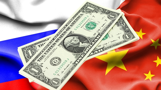 The US believes that Russia and China cannot afford to dethrone the USD