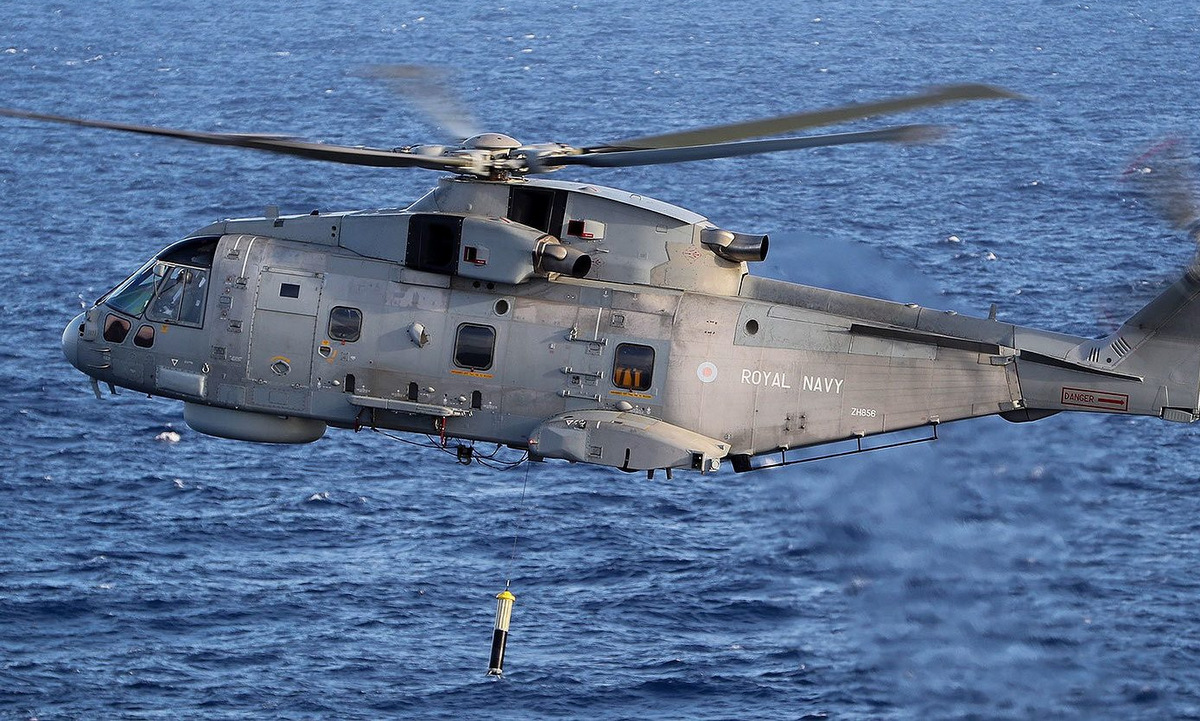 The Merlin Mk 2 helicopter drops sonar buoys during a drill.  Photo: Royal Navy.