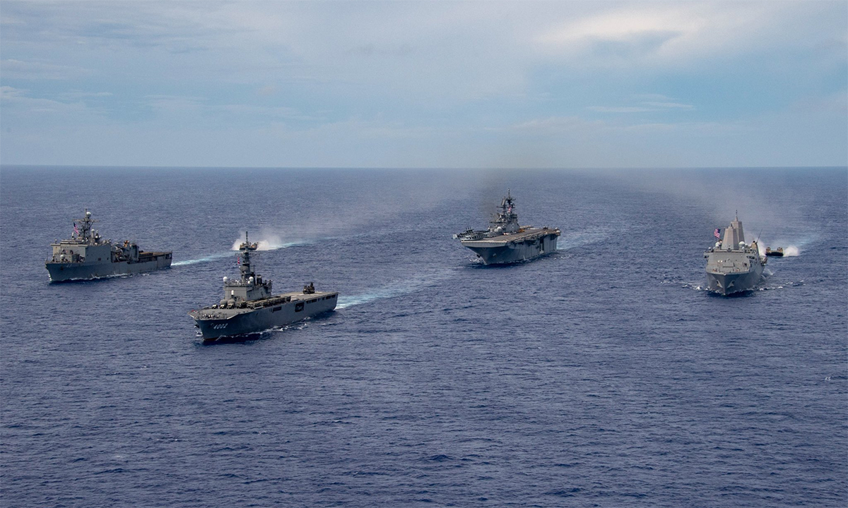 From left, amphibious assault ship USS Germantown, JS Shimokita, helicopter carrier USS Ameria and amphibious ship USS New Orleans exercise off Okinawa, Japan on June 12.  Photo: JMSDF.