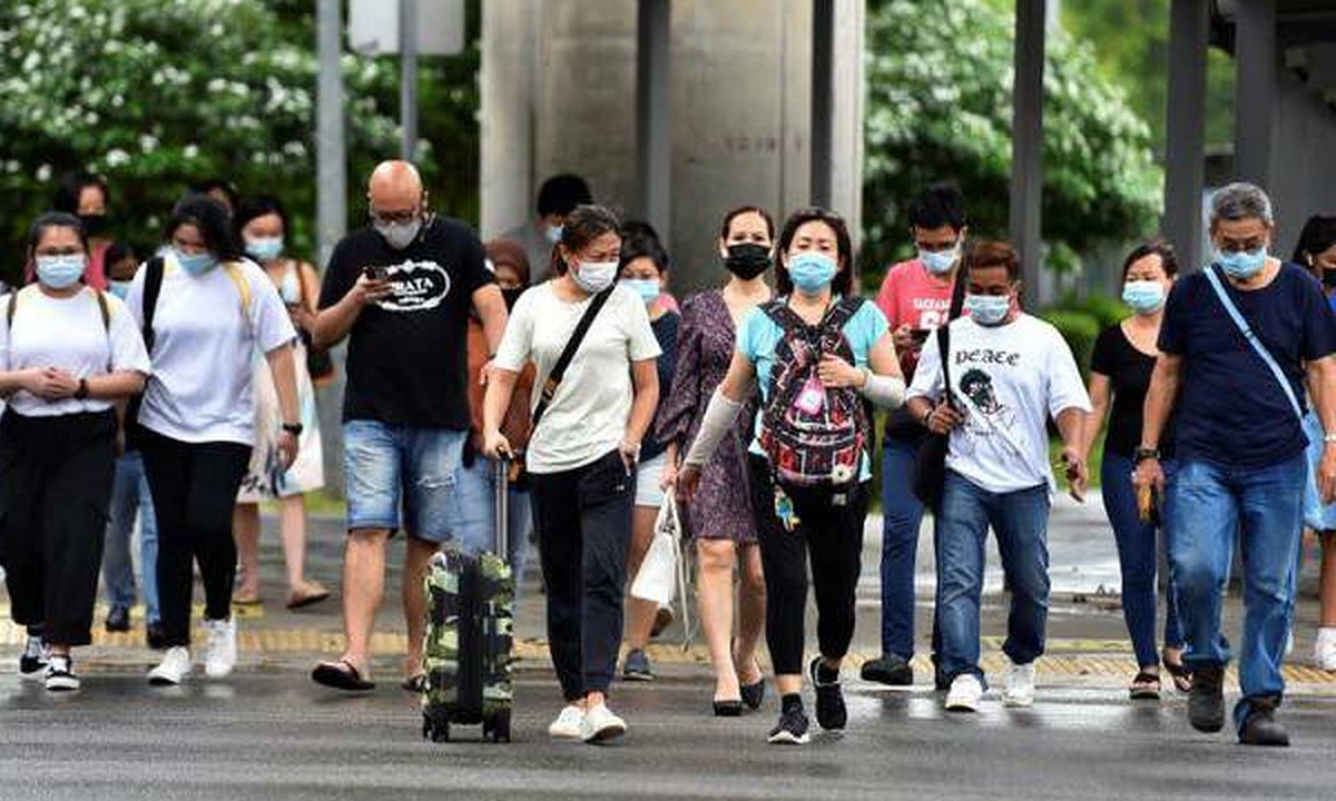 Singaporeans were required to wear masks when going out during the outbreak of community infection in May. Photo: Reuters.